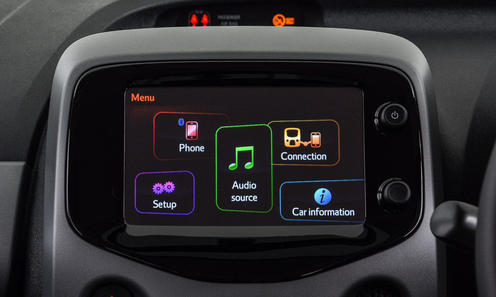 The infotainment system features a touchscreen.