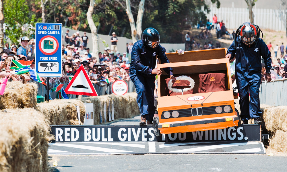 Determined to finish, team Gusheshe carries its BMW 325 iS-inspired cart to the line.  Photo: Mpumelelo Macu/Red Bull Content Pool