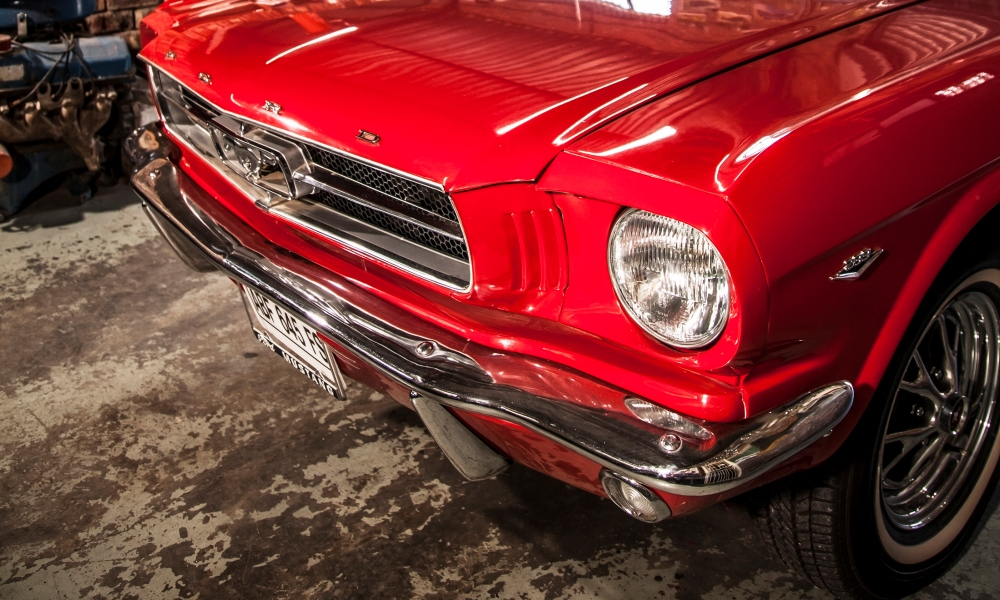 The front of a restored 1964-and-a-half Ford Mustang Cabriolet.