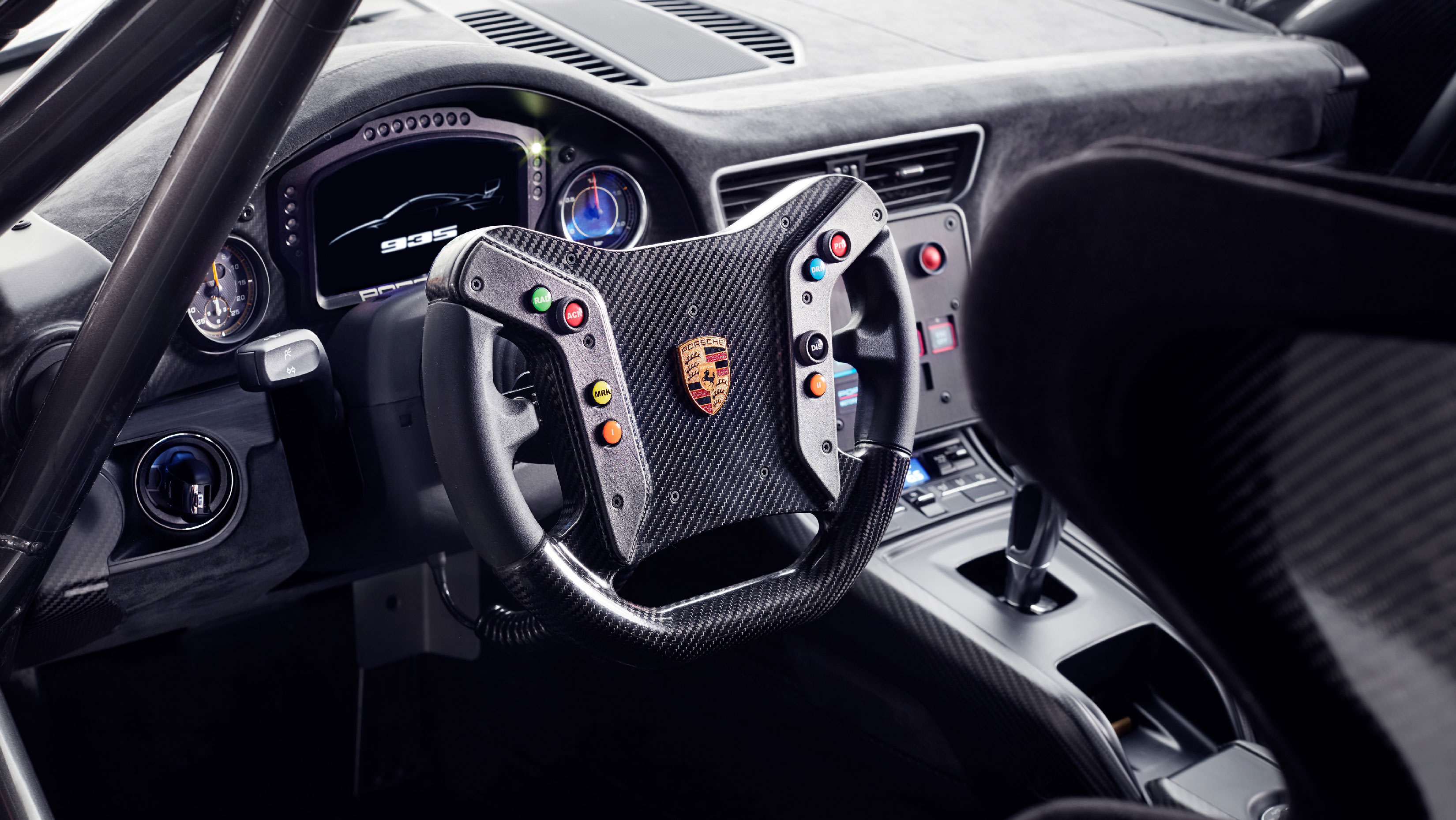 The laminated wood gear knob is reminiscent of the 917, 909 Bergspyder and Carrera GT.