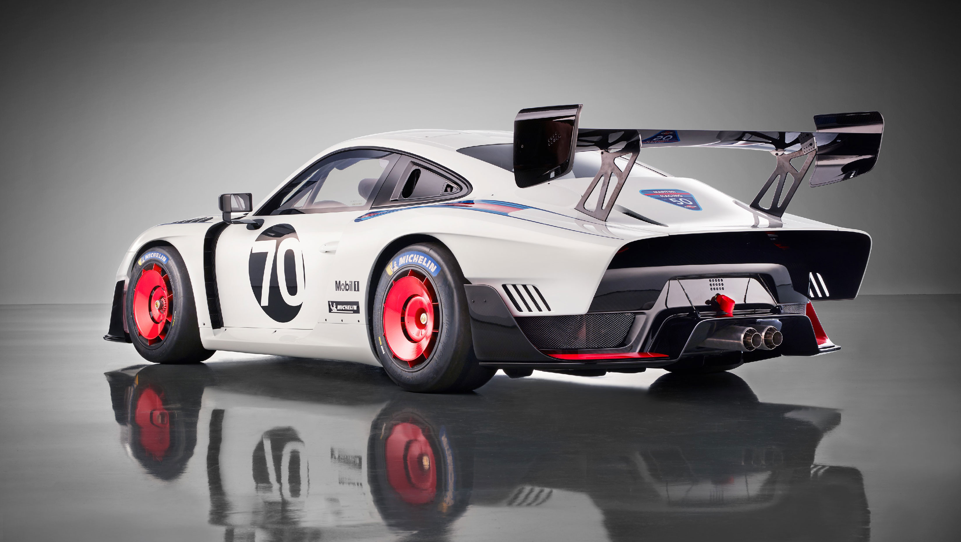 "The new 935 pays tribute to the Porsche 935/78 Le Mans race car, which fans dubbed ""Moby Dick"" due to its elongated shape, massive fairings and white base colour."