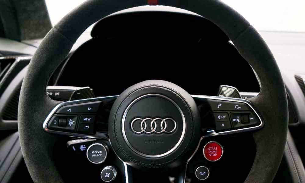 Alcantara covers the steering wheel while the paddles are formed with carbon fibre.