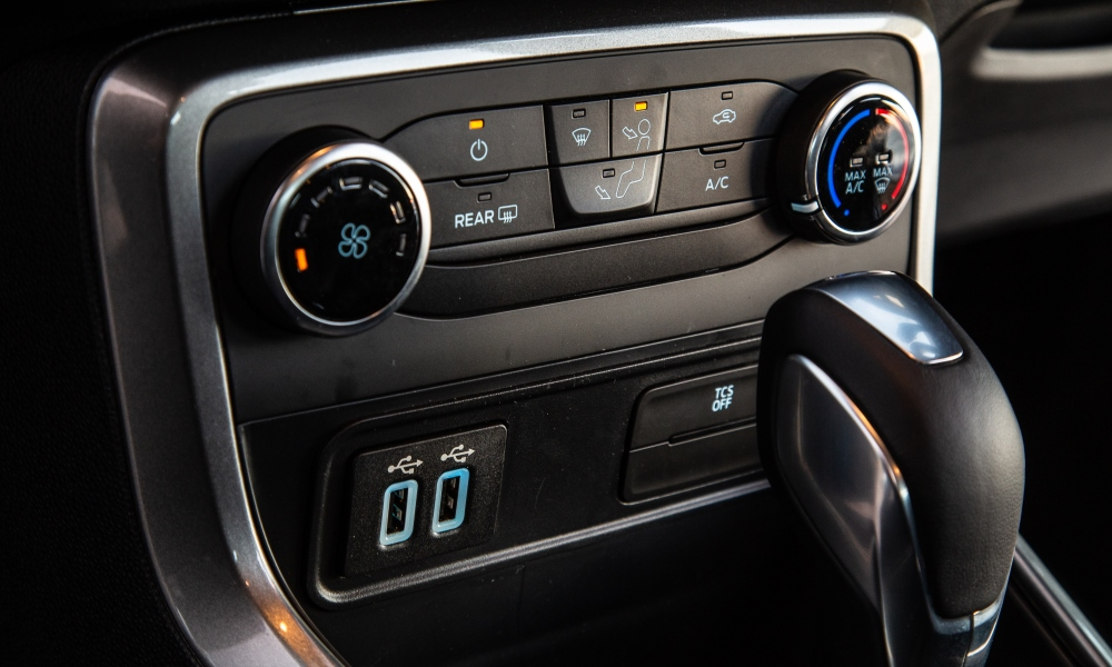 Dual USB ports feed a smartphone-enabled Sync3 infotainment system.