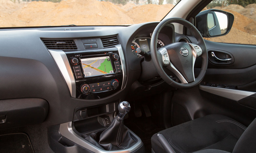 The basic cabin features an infotainment system and comfortable cloth seats.