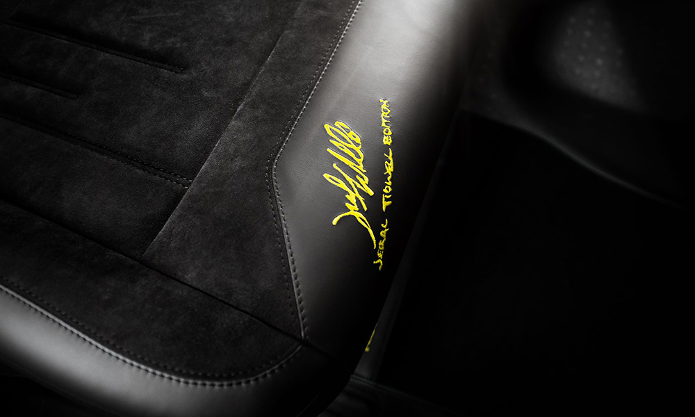 The artist's signature can be seen throughout the cabin and on the exterior bodywork.