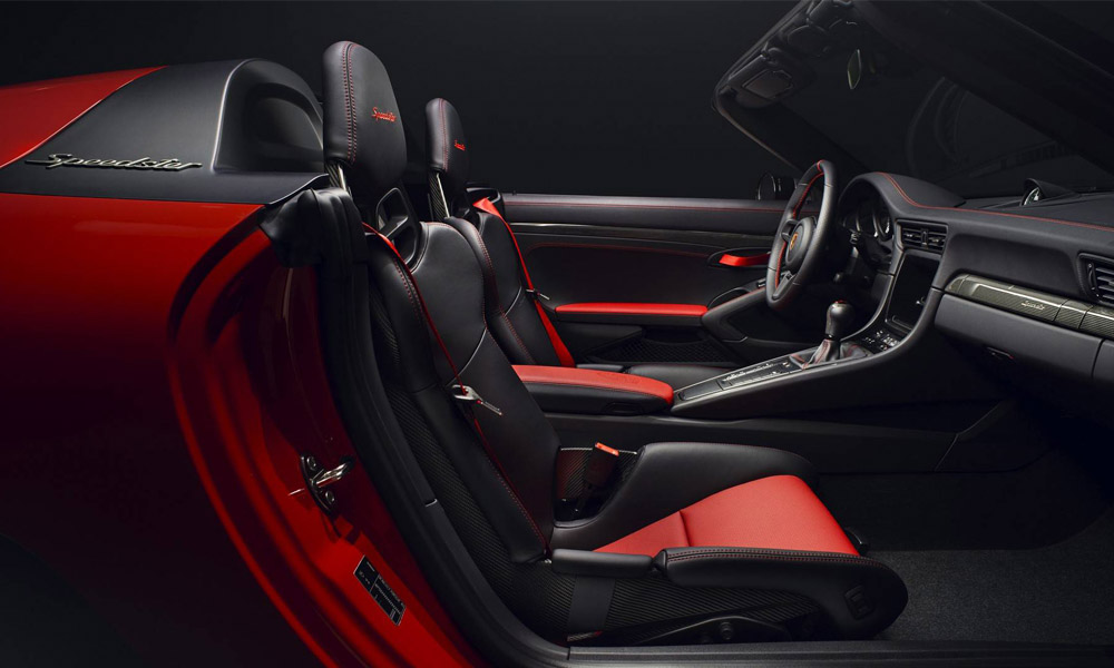 Black leather upholstery with red highlighting.