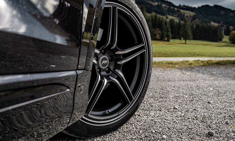 This model rides on ABT's 22-inch matte black wheels.