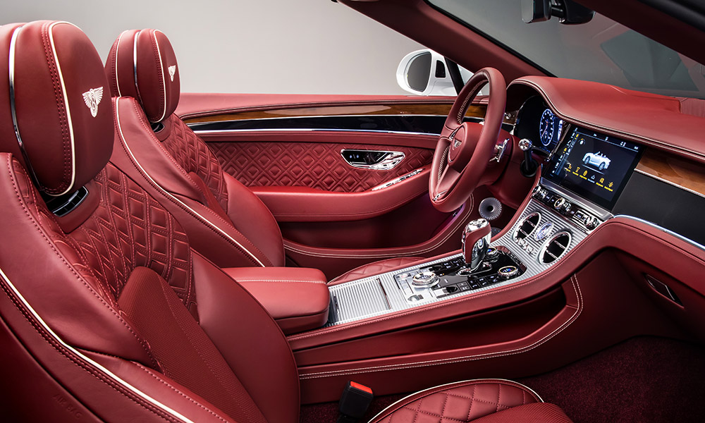 The interior mirrors that of the coupé and features high-quality leather and veneer.