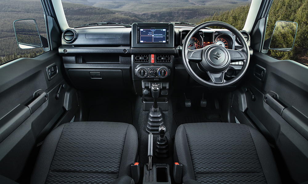 Cabin is solid and functional with traditional transfer case selector lever.