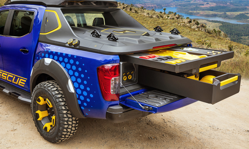 The cargo bed holds battery packs and a handy set of drawers.
