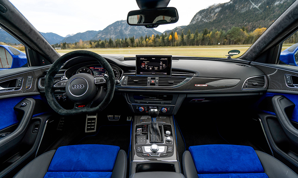Blue accents are present in the Alcantara- and leather-clad interior, too.