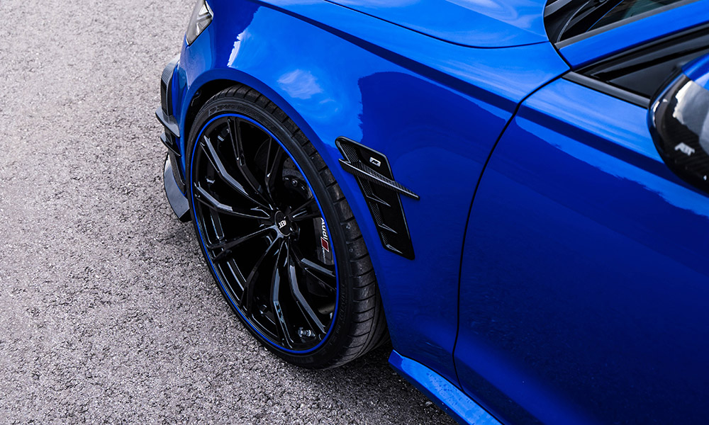 The 22-inch black wheels feature Nogaro Blue accents.