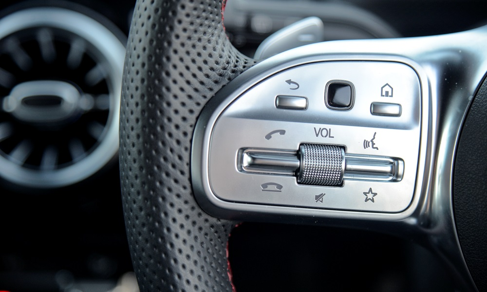 Tactile steering buttons.