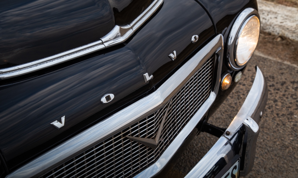 Rectangular grille and round lights typical of early Volvos.
