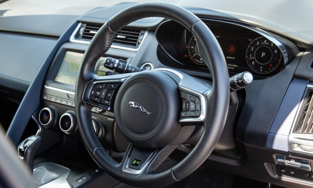 Cabin design mimics that of the F-Type coupé.