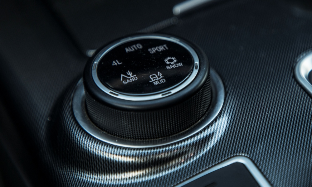 Driving modes include sport and a low-range setting.