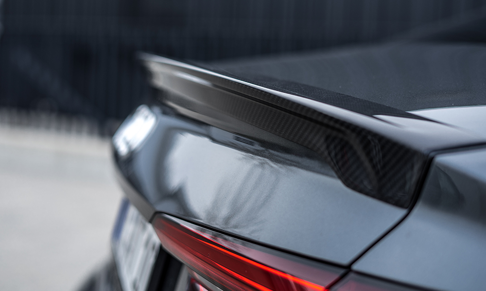 The rear spoiler is fashioned from carbon-fibre-enhanced plastic.