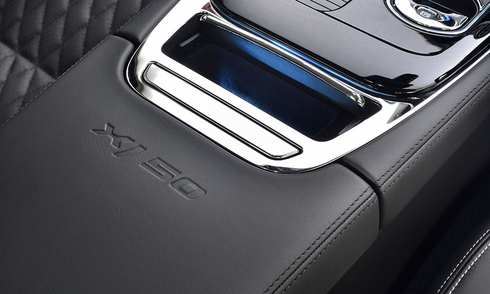 The interior features an embossed XJ50 logo on the center armrest.